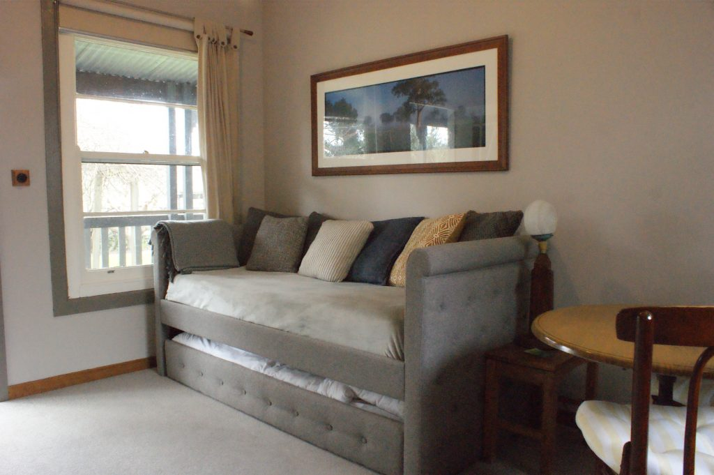 Sofa/trundle creates two more single beds - Barwon Suite